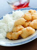 Sweet and sour chicken with dipping sauce. Stock Photo