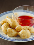 Sweet and sour chicken with dipping sauce closeup. Close up photo of chinese sweet and sour chicken with dipping sauce Royalty Free Stock Images