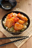 Sweet and sour chicken. Cantonese style with egg fried rice in a lacquer bowl with chopsticks Royalty Free Stock Images