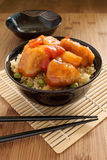 Sweet and sour chicken. Cantonese style with egg fried rice in a lacquer bowl with chopsticks Royalty Free Stock Photos