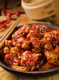 Sweet and Sour Chicken. Lightly breaded, all white meat chicken breast pieces in a sweet and tangy spicy sauce garnished with sesame seeds royalty free stock image