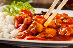Sweet and sour chicken with rice Stock Photos