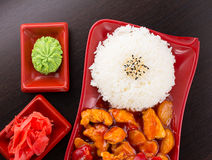 Sweet and sour chicken with rice on a plate Stock Photography
