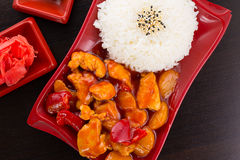 Sweet and sour chicken with rice on a plate Stock Image