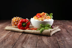 Sweet and Sour Chicken on Rice. On wooden background Royalty Free Stock Image
