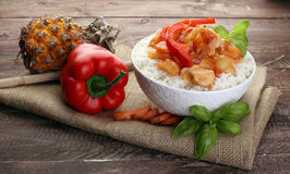 Sweet and Sour Chicken on Rice on wooden background. Sweet and Sour Chicken on Rice Stock Image