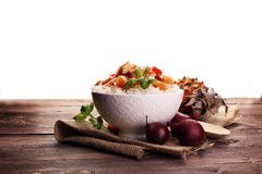 Sweet and Sour Chicken on Rice on wooden background. Sweet and Sour Chicken on Rice Royalty Free Stock Photography