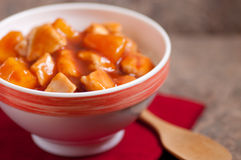 Sweet and sour chicken. Tangy sweet and sour chicken over white rice Stock Image