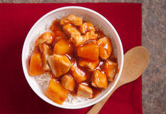 Sweet and sour chicken. Tangy sweet and sour chicken over white rice Stock Photos