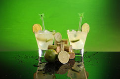 Sweet & sour cocktail. Caipirinha, whiskey sour or pisco sour with sugar cane and lime Royalty Free Stock Photo