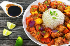 Sweet and Sour fried pork chunks with vegetables and rice Royalty Free Stock Images