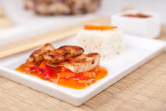 Sweet and sour meat on white rice Royalty Free Stock Photo