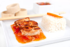 Sweet and sour meat on white rice Stock Photography