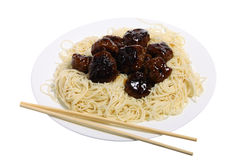 Sweet and sour meatballs and chopsticks Royalty Free Stock Photo
