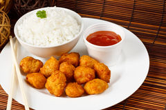 Sweet and sour pork balls. Sweet and sour battered pork balls with boiled rice Stock Image