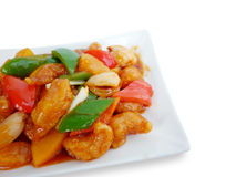 Sweet and sour pork with fruit salad Stock Photos