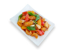 Sweet and sour pork with fruit salad Stock Photo