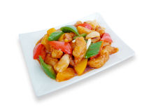 Sweet and sour pork with fruit salad Stock Image