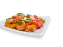 Sweet and sour pork with fruit salad Stock Images