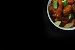 Sweet and Sour Pork on Pure Black Background Royalty Free Stock Photo