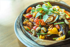 Sweet and sour sauce fried sea food with cashew nut Stock Photo