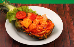 Sweet and sour shrimp in pineapple thai style Royalty Free Stock Photos