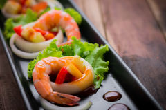 Sweet and sour shrimp, prawn cocktail on long square dish and wo Stock Image