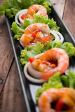 Sweet and sour shrimp, prawn cocktail on long square dish and wo Royalty Free Stock Photography