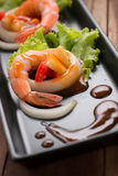 Sweet and sour shrimp, prawn cocktail on long square dish and wo Stock Photography