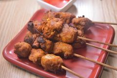 Sweet and Sour Skewer. Grilled BBQ Chicken skewer sticks sweet and Sour sauce royalty free stock image