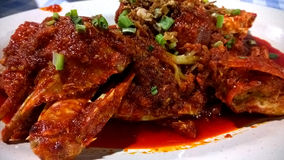 Sweet and sour source chilli crab cuisine, that is famous in Singapore. Stock Photos