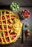 Sweet and sour tart made of fresh berry fruits Stock Photography