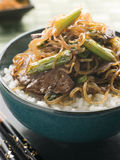 Sweet Soy Beef Fillet with Shirataki Noodles. Bowl of Sweet Soy Beef Fillet with Shirataki Noodles on Rice with chopsticks stock photos