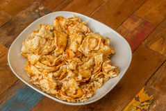 Sweet and spicy indonesian chips emping blado Royalty Free Stock Photo