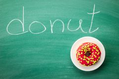 Sweet sprinkled donut. Royalty Free Stock Images