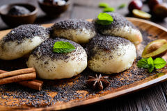 Sweet steamed dumplings with a plum jam sprinkled with ground poppy seeds. Traditional sweet steamed dumplings with a plum jam, sprinkled with ground poppy seeds Royalty Free Stock Photo