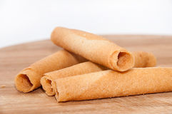Sweet sticks for ice cream on the wooden board Royalty Free Stock Photography