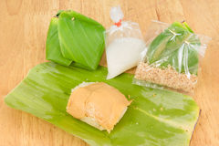 Sweet sticky rice, dessert Thai wrapped in banana leaves. Royalty Free Stock Images