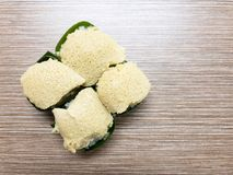 Sweet sticky rice with Egg custard and Sweet Coconut topping, wrapped in banana leaf. Popular Thai Dessert. Royalty Free Stock Images