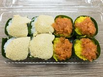 Sweet sticky rice with Egg custard and Sweet Coconut topping, wrapped in banana leaf. Popular Thai Dessert. Stock Image