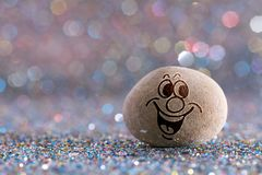 The sweet stone emoji. Emotions on color glitter boke background royalty free stock images