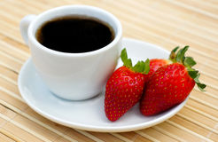 Sweet strawberries and coffee. Sweet strawberries and cup of coffee Royalty Free Stock Images