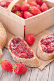 Sweet strawberries jam on bread slice. Royalty Free Stock Images