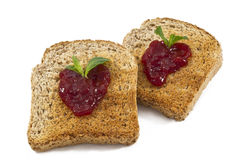 Sweet strawberries jam on toast close up Royalty Free Stock Photography