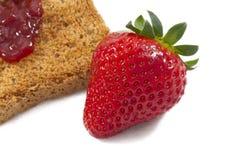 Sweet strawberries jam on toast close up Royalty Free Stock Photos
