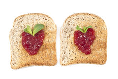 Sweet strawberries jam on toast close up Royalty Free Stock Image