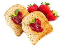 Sweet strawberries jam on toast close up Stock Photos