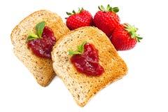 Sweet strawberries jam on toast close up Stock Photos