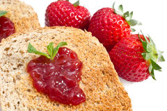 Sweet strawberries jam on toast close up Royalty Free Stock Image