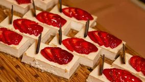 Sweet Strawberry Delight Layered Bars. Sliced strawberries top this delicious layered cream cheese dessert treat stock footage